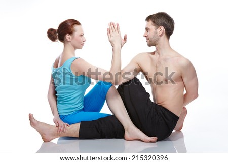 man and woman doing yoga
