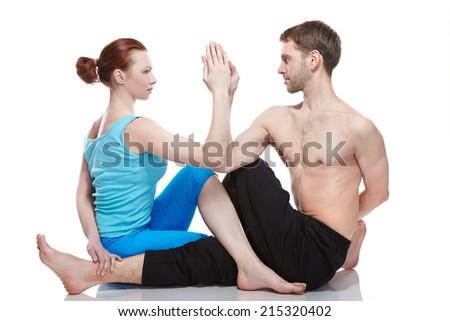 man and woman doing yoga - stock photo