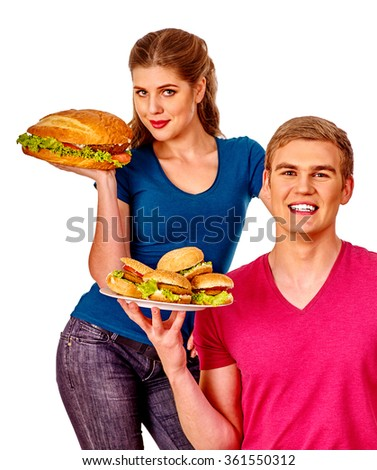 Man and woman eating big sandwich with cola.  Isolated. - stock photo