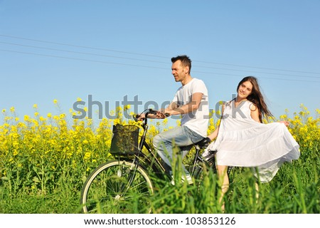Man and woman enjoying the spring - stock photo