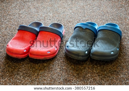 Man and woman garden slippers on a carpet. - stock photo