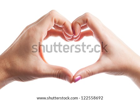 Man and woman hand creating heart isolated on white - stock photo