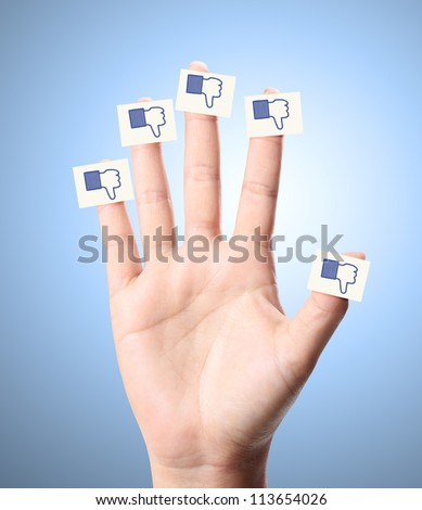 Man and woman hands With like do not like