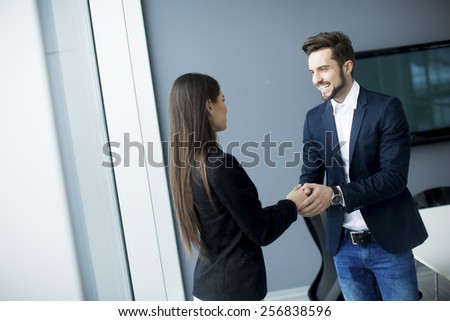 Man and woman handshaking in the office