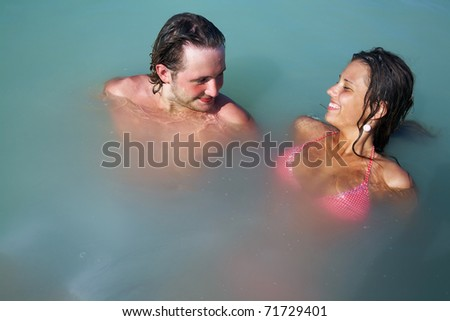 man and woman have good time in open water on resort - stock photo