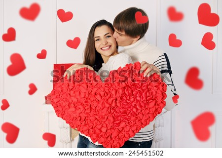 Man and woman holding a big beautiful heart - stock photo