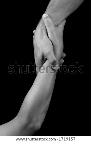 man and woman holding each others arms - stock photo