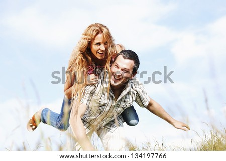 man and woman hug in the sky
