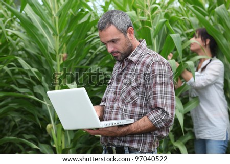 man and woman in a field - stock photo