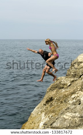 man and woman in a jump - stock photo
