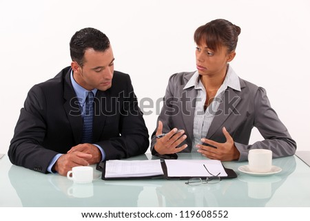 Man and woman in businessmeeting - stock photo