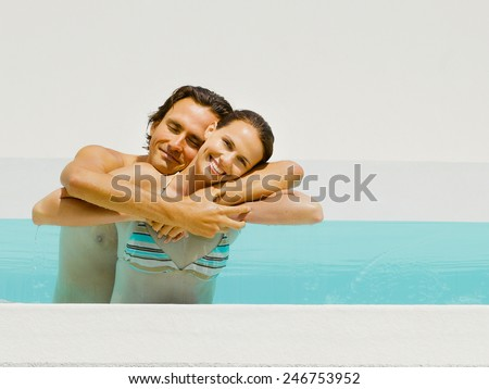 man and woman in hotel pool - stock photo