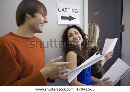 Man and woman in line for casting - stock photo
