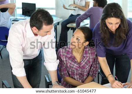 Man and woman in office - stock photo