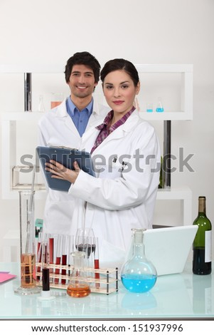 Man and woman in science laboratory - stock photo