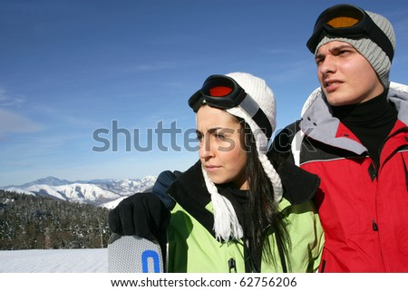 Man and woman  in snowy landscape - stock photo