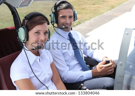 Man and woman in the cockpit - stock photo