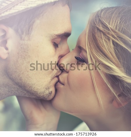 Man and woman kissing - stock photo