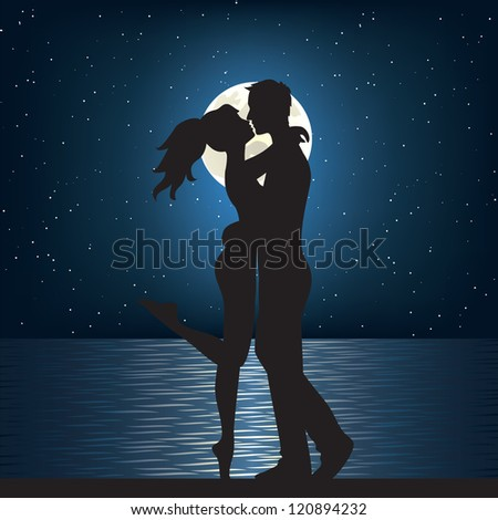 Man and woman kissing on the sea at night. - stock photo