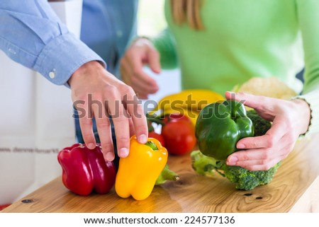 Man and woman living vegetarian and healthy by eating fruits and vegetables  - stock photo