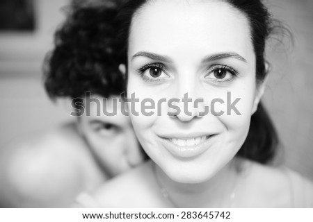 man and woman looking into the camera. Black and white picture - stock photo