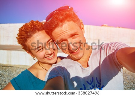 man and woman looks into the camera  - stock photo