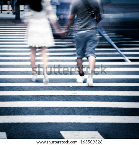 man and woman lover hand by hang walking on city zebra crossing street - stock photo