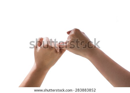 Man and woman making a pinkie promise isolated on white background - stock photo