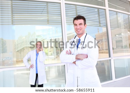 Man and woman medical team  in front of hospital