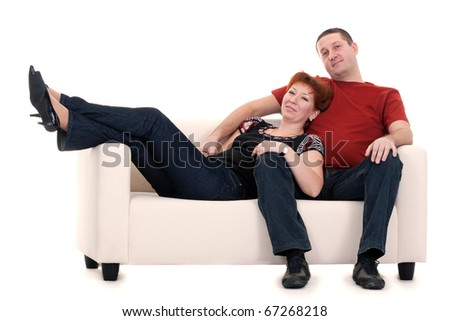 Man and woman on a sofa on a white background - stock photo