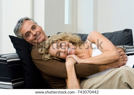 Man and woman on sofa