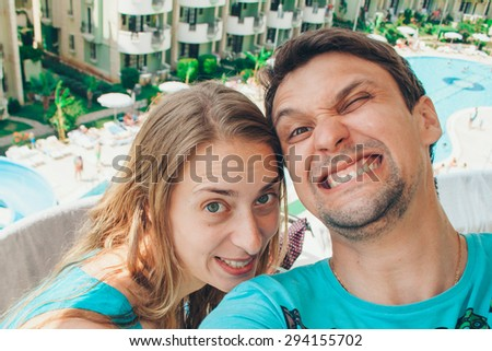 man and woman on the background of the hotel and the sea - stock photo