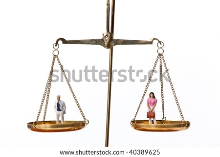 Man and woman on Waage.Symbol for equality