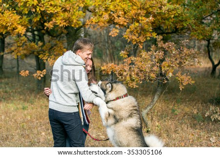 Man and woman playing with the dog