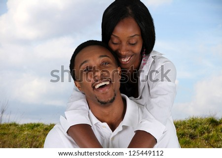 Man and woman posing together outside in nature