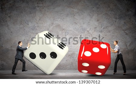 Man and woman pulling dices. Interaction concept - stock photo