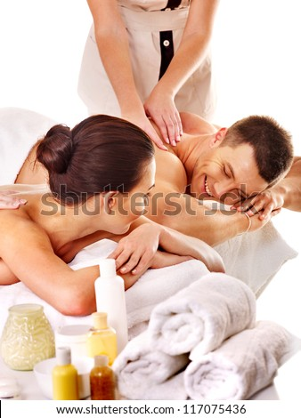 Man and woman relaxing in spa. Isolated. - stock photo