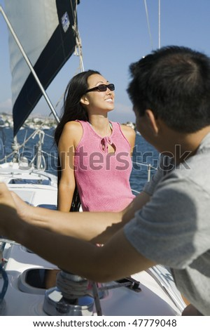 Man and Woman Sailing - stock photo