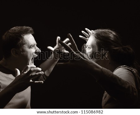 Man and woman screaming at each other. Marriage before the divorce. OTHER PHOTOS FROM THIS SERIES IN MY PORTFOLIO. - stock photo