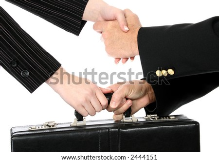 Man and woman shaking hands and passing briefcase over white.
