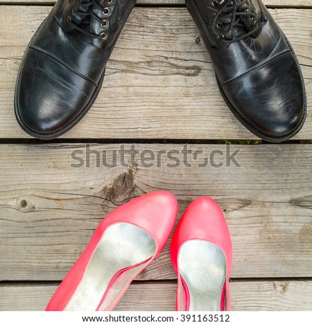 Man and woman shoes over wooden floor background. concept of date - stock photo
