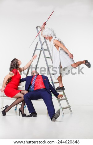 Man and woman sitting on a bench - stock photo