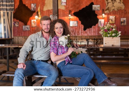 man and woman sitting on a bench in saloon - stock photo