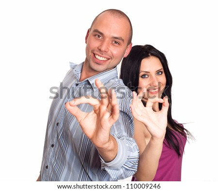 Man and woman  smiling and showing you OK sign - stock photo
