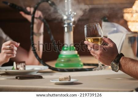 man and woman smoking hookah - stock photo