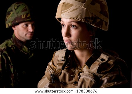 Man And Woman Soldiers - stock photo
