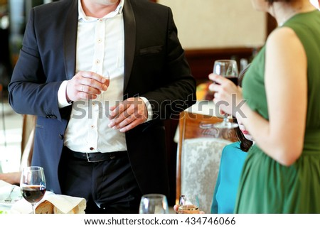man and woman toasting and congratulating, happy festive moment, luxury celebration concept - stock photo