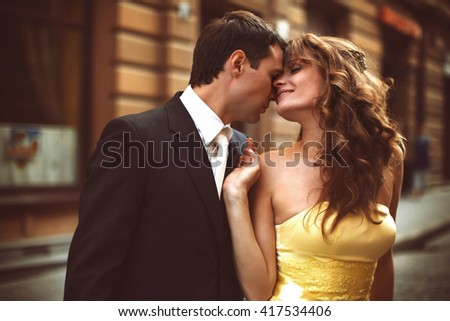 Man and woman touch each other heads tender
