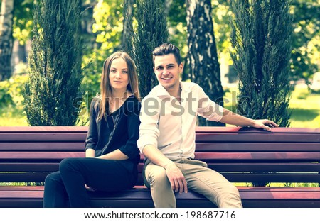 man and woman walking in the park - stock photo