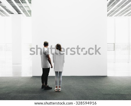Man and woman walking through the gallery  - stock photo